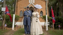 Descendants of American Southerners Philip Logan and his wife Eloiza Logan, pose for pictures during a party to celebrate the 150th anniversary of the end of the American Civil War in Santa Barbara d'Oeste, Brazil, Sunday, April 26, 2015. Thousands turn out every year, including many of those who trace their ancestry back to the dozens of families who, enticed by the Brazilian government's offers of land grants, settled here from 1865 to around 1875, as well as country music enthusiasts, history buffs and locals with a hankering for buttermilk biscuits. (AP Photo/Andre Penner)