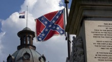 The Confederate Flag on the grounds of the South Carolina State House flies at full staff while the U.S. and state flags are at half mast following the killing of nine black churchgoers in Charleston by a white gunman.